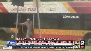 Armed robbery suspect dead, officer shot after shootout in Dundalk - Video