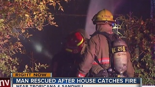 Man rescued in overnight house fire.