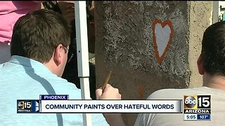 Community paints over hateful words in Phoenix neighborhood - Video