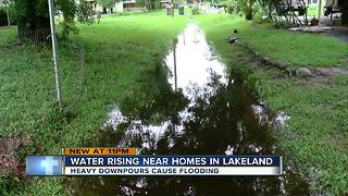 Unseasonable rains have Lakeland residents on edge as flood waters rise - Video