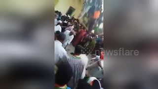 Horrifying moment a crowded balcony falls on temple worshippers - Video