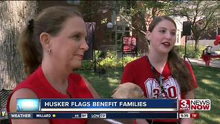 Husker flags benefit families in need - Video