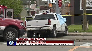 Man shot and killed while sitting in vehicle