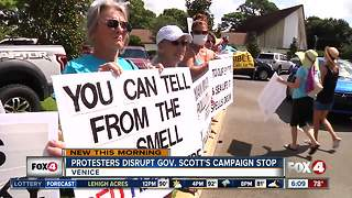 Gov. Scott confronted by protesters at campaign stop