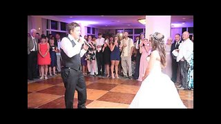 Groom surprises bride with singing performance at reception - Video