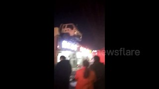 Driver's truck ends up on restaurant roof - Video