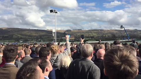 Race-goers watch the action as Cheltenham Festival gets underway
