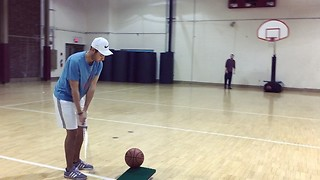 Dude sinks long basketball shot using golf club - Video