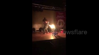 Man 'breathes' fire through his bottom - Video