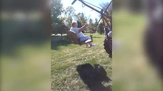 Senior Woman Enjoys A Ride On A Bench Attached To A Tractor - Video