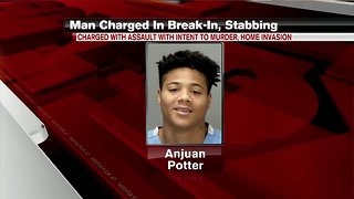 Lansing man charged in stabbing