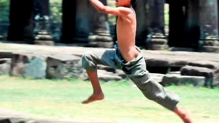 Really Brave Boy Jumping In Deep Pond Near Angkor Thom Temple Cambodia