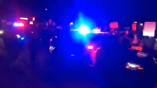 Deputy Warns Protester in Cruiser's Way, Takes Her Down, Keeps Right on Rolling