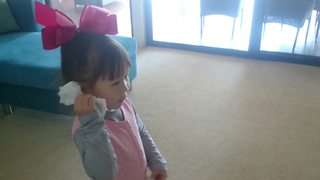 Little girl uses hair clip to