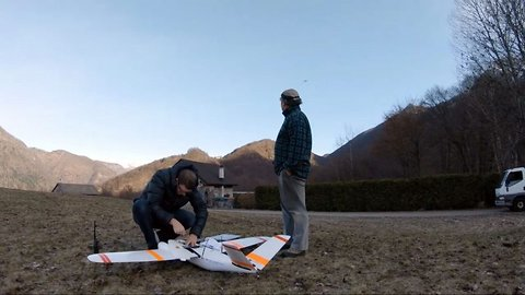Drone captures stunning footage of mountain peaks as it flies over alps to deliver mail