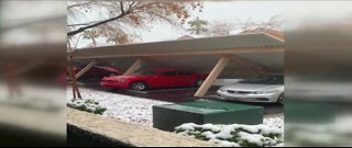 Carport collapses, traps multiple cars