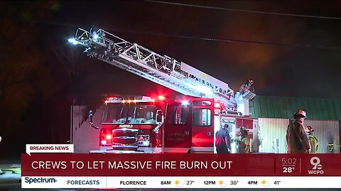 Crews to let massive fire burn out