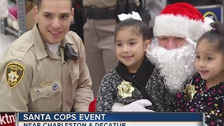 Santa flies to Walmart in police helicopter for Santa Cops event - Video