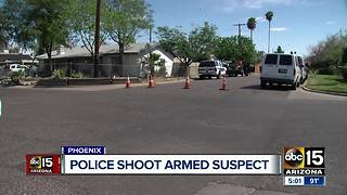 Phoenix officer shoots armed suspect - Video