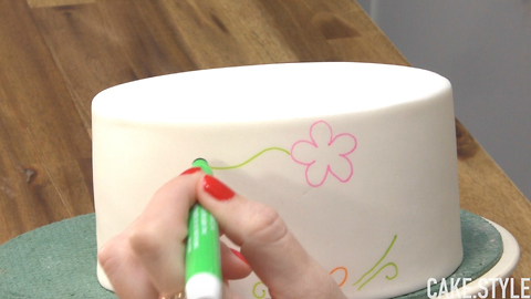 She draws on a cake, but it's not what you think..