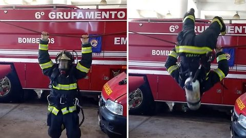 These gymnastics are lit: Pumped up fireman performs impressive gymnastics on wire wearing full kit