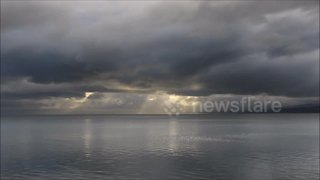 Gorgeous time-lapse of clouds and sunbeams over Northern Ireland lake - Video