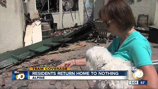 Alpine residents return home to nothing - Video