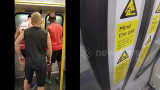 Runners race London underground train to the next stop - Video