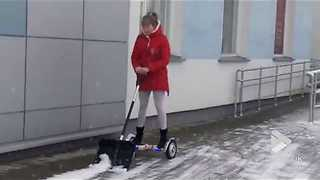 Woman Makes Good Use Of Hoverboard After A Snowy Day - Video