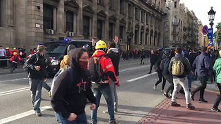Riot Police Confront Protesters Blocking Streets in Barcelona - Video