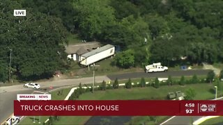 Semi-truck crashes into side of a house in Tampa