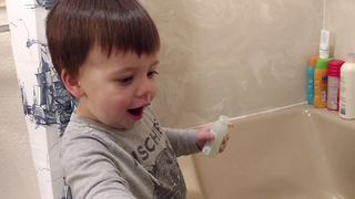 A Tot Boy Gets Very Excited About Taking A Bath