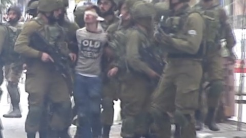 Blindfolded Boy Arrested by More than a Dozen Soldiers During Hebron Protests