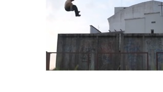 Daredevil Jumps Off a Two-Story Building in a Perfect Double-Sided Flip - Video
