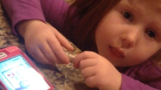Little Girl Tries to Put Money in a Cell Phone - Video