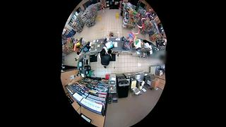 Surveillance video: Clerk fights with would-be robber in 7-Eleven store - Video