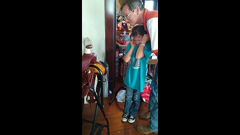 Little girl cries tears of happiness over Christmas gift