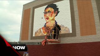 Local artist paints mural for CineLatino Film Festival - Video