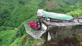 Video shows truck half-dangling off cliff after driver loses control - Video