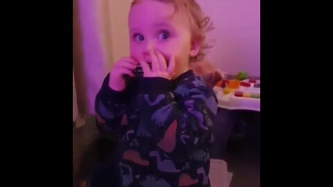 Toddler shows off adorable harmonica skills