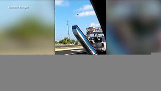 Video of man pulling boat goes viral - Video