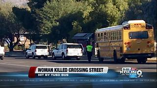 Pedestrian hit by school bus dies - Video