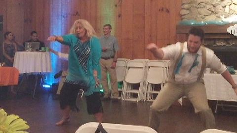 Mother and son deliver epic surprise wedding dance