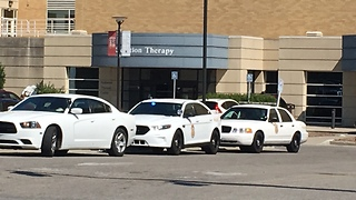 Off-duty Southport police officer tried to apprehend robbery suspect; suspect struck officer with vehicle