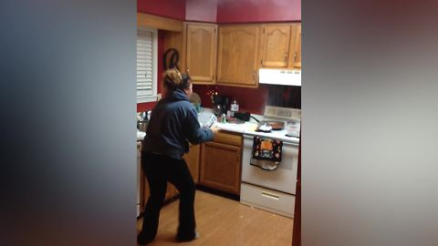 A Woman Tries To Make Popcorns And Sets The Stove On Fire