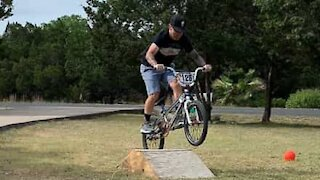 Man fails bicycle jump in style