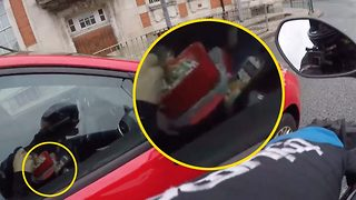 Cereal offender: 'Brain dead' Driver caught eating sugar puffs at the wheel – with two phones - Video