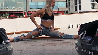 Woman performs epic split on two vehicles