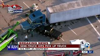 Semi, truck crash creates fuel spill in South Bay - Video