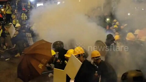 Hong Kong police fire tear gas as protesters approach police lines
